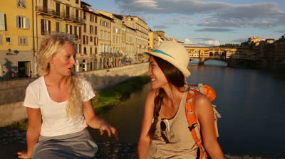 stock-footage-happy-women-girl-friends-on-travel-in-florence-talking-together-cheerful-girlfriends-smiling-happy